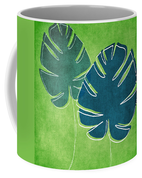 Palm Tree Coffee Mug featuring the painting Blue and Green Palm Leaves by Linda Woods