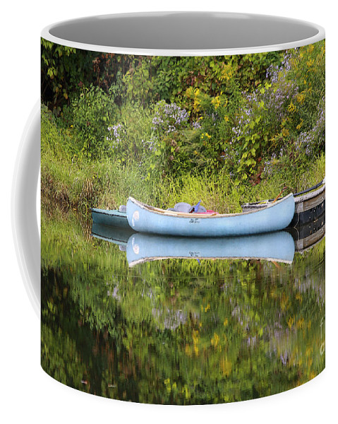 Pond Coffee Mug featuring the photograph Blue Canoe by Deborah Benoit