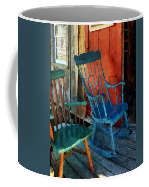 Porch Coffee Mug featuring the photograph Blue Chair Against Red Door by Susan Savad