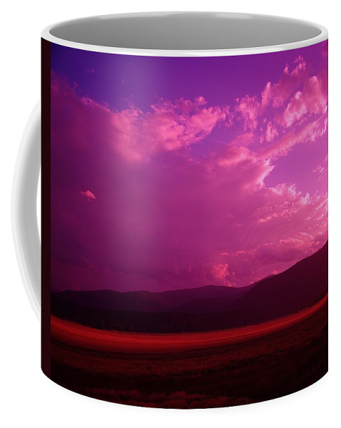Clouds Coffee Mug featuring the photograph Blue In Bonners Ferry by Jeff Swan