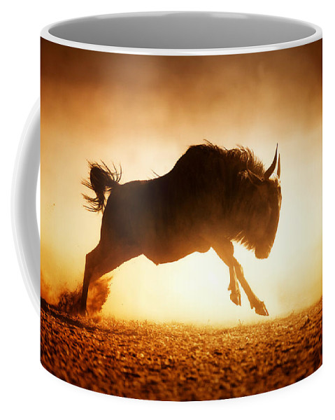 Wildebeest Coffee Mug featuring the photograph Blue Wildebeest Running In Dust by Johan Swanepoel