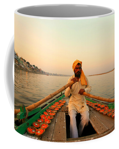 Hindu Pilgrim Coffee Mug featuring the photograph Boat Man On The Ganges River At Varanasi by Amanda Stadther