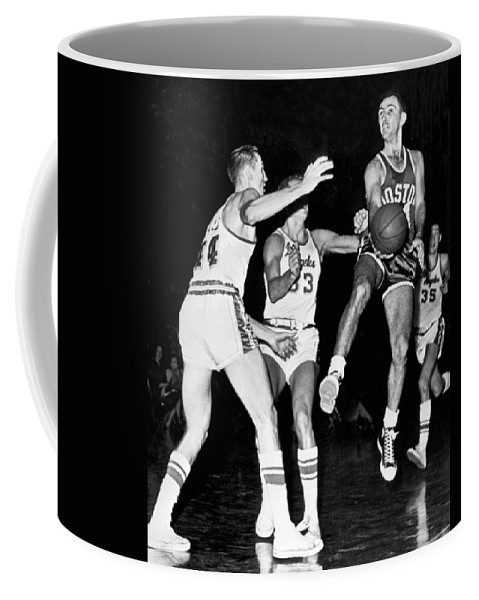 4350af73c 1950s Coffee Mug featuring the photograph Bob Cousy Passes Basketball by  Underwood Archives