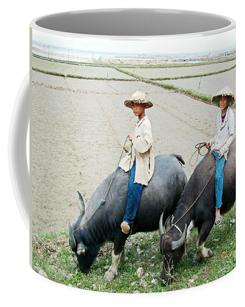 Boys On Water Buffalo In Countryside Coffee Mug featuring the photograph Boys On Water Buffalo In Countryside-vietnam by Ruth Hager
