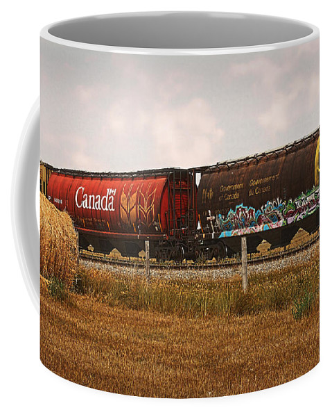 Railroad Coffee Mug featuring the photograph Bringing In The Wheat Canadian Railroad by Terry Fleckney