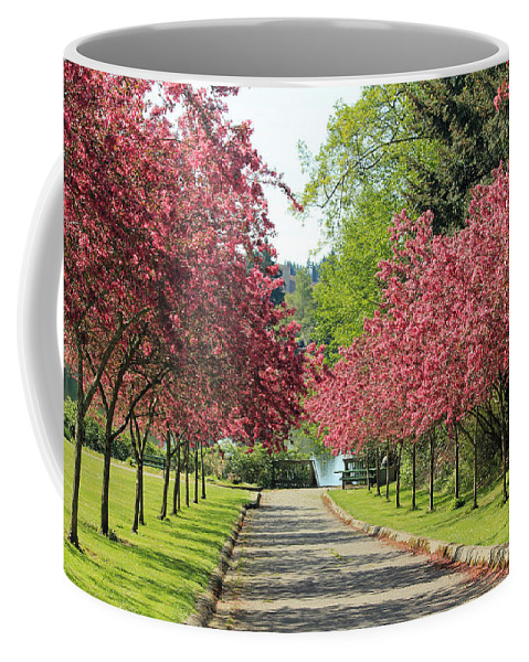 Grass Coffee Mug featuring the photograph Bursting With Spring by E Faithe Lester
