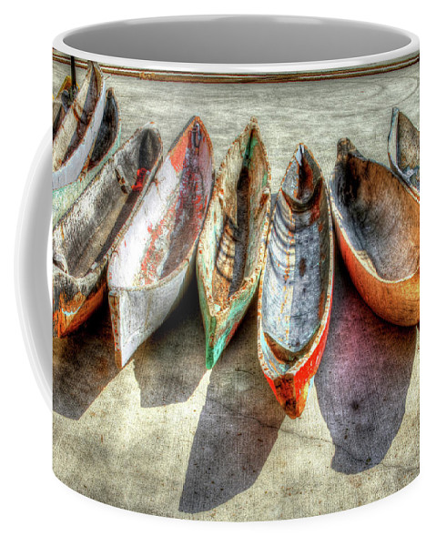The Coffee Mug featuring the photograph Canoes by Debra and Dave Vanderlaan