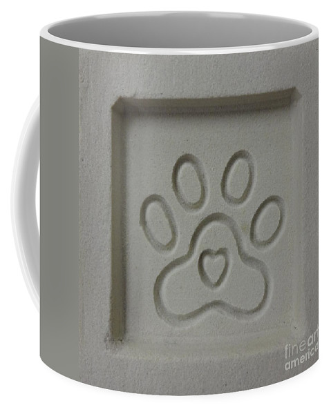 Paw Print Coffee Mug featuring the photograph Carved Sand Paw Print by Megan Cohen