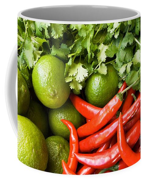 Red Coffee Mug featuring the photograph Chillies And Limes by Rick Piper Photography
