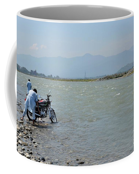 Pakistan Coffee Mug featuring the photograph Cleaning Motorcycle At Riverside Swat Valley Pakistan by Imran Ahmed