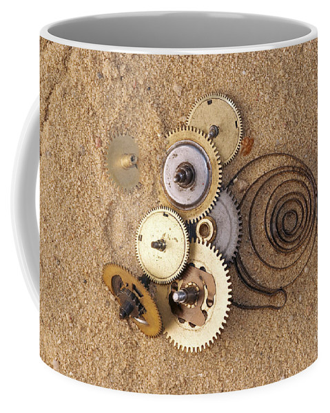 Clockwork Coffee Mug featuring the photograph Clockwork Mechanism On The Sand by Michal Boubin