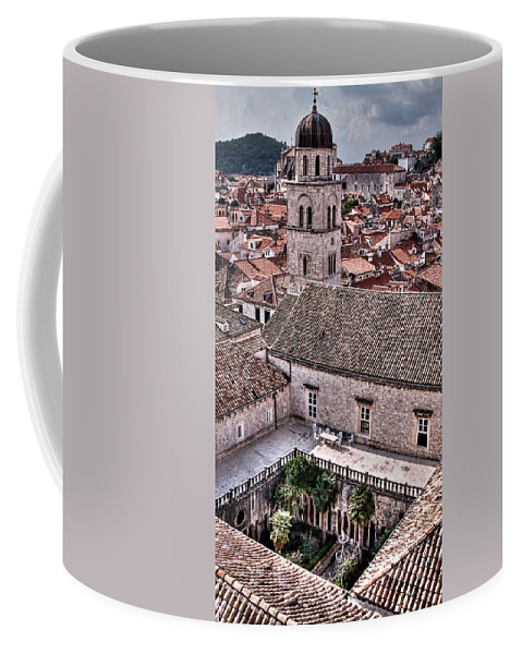 Cloister Coffee Mug featuring the photograph Cloistered Garden And Tower In The White City by Weston Westmoreland