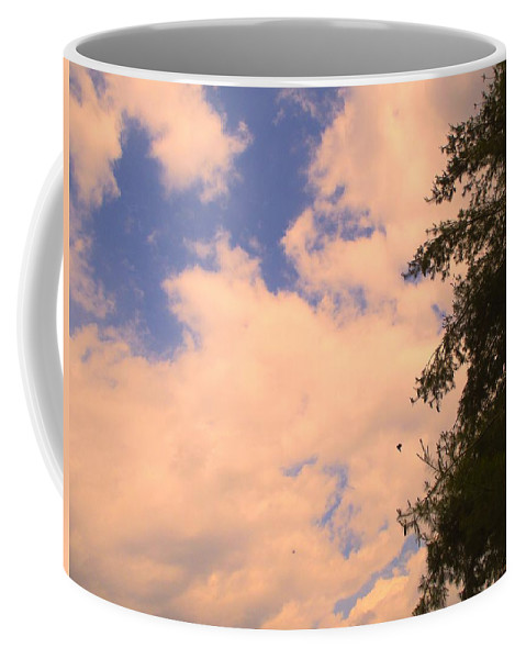 Clouds Coffee Mug featuring the photograph Cloud Slide by Kendall Kessler