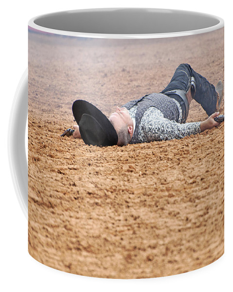 Rodeo Coffee Mug featuring the photograph Color Rodeo Gunslinger Victim by Sally Rockefeller