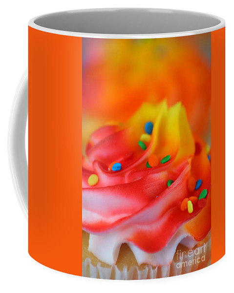 Against Coffee Mug featuring the photograph Colorful Cup Cake by Darren Fisher