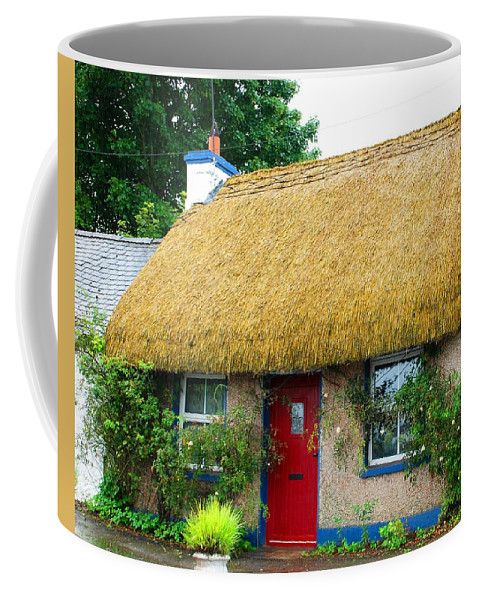 Thatch Coffee Mug featuring the photograph Colorful Irish Cottage by Charlie and Norma Brock