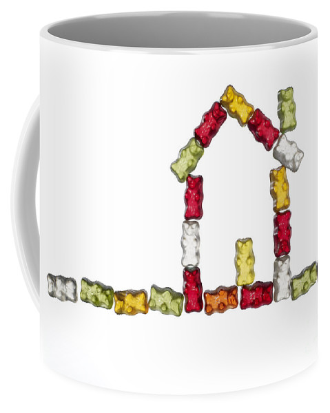 Symbol Coffee Mug featuring the photograph Coloured Jellybabies Formed As A House by Juergen Ritterbach