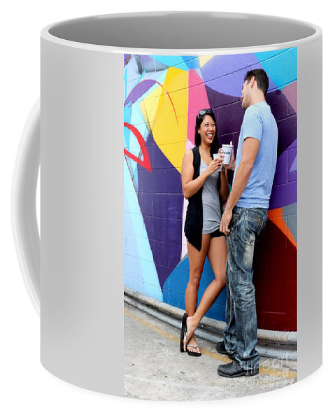 Couple Coffee Mug featuring the photograph Couple Talking by Henrik Lehnerer