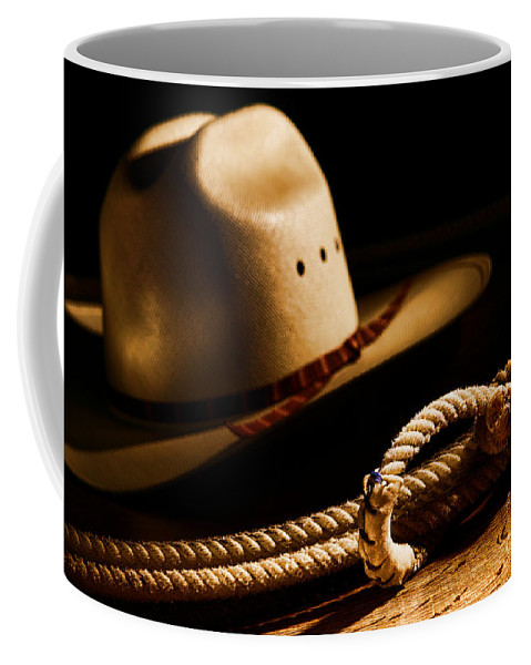 Western Coffee Mug featuring the photograph Cowboy Hat And Lasso by Olivier Le Queinec