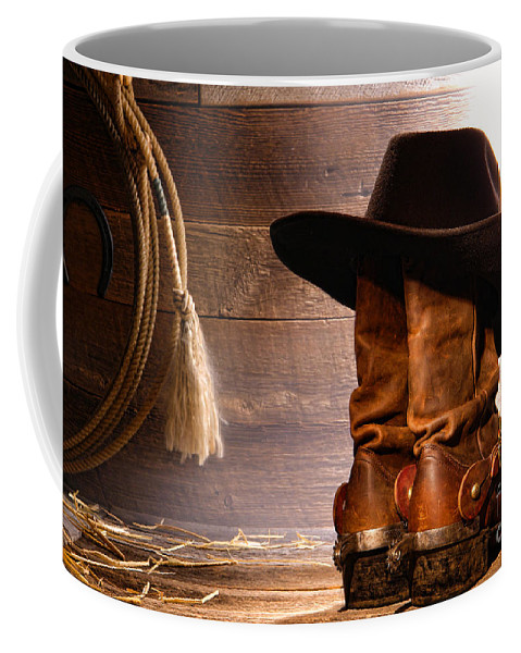 Western Coffee Mug featuring the photograph Cowboy Hat On Boots by Olivier Le Queinec