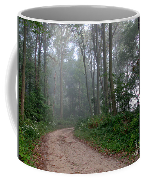 Path Coffee Mug featuring the photograph Dirt Path In Forest Woods With Mist by Olivier Le Queinec