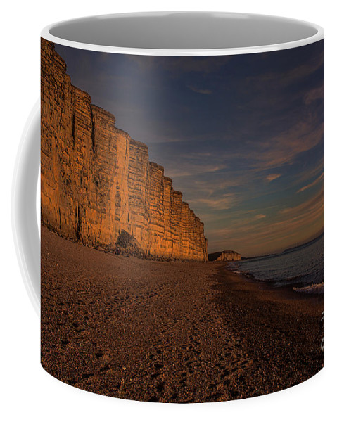 East Cliff Coffee Mug featuring the photograph East Cliff Sunset Dorset by Chris Thaxter