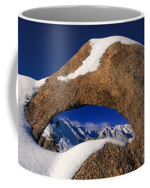 North America Coffee Mug featuring the photograph Eastern Sierras Through Snow Covered Arch by Dave Welling