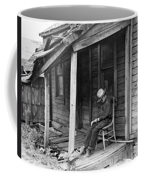 1936 Coffee Mug featuring the photograph Elderly Man Doses On His Porch by Underwood Archives