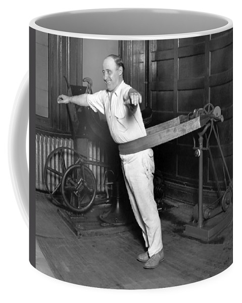 1035-276 Coffee Mug featuring the photograph Electrical Vibrating Machine by Underwood Archives