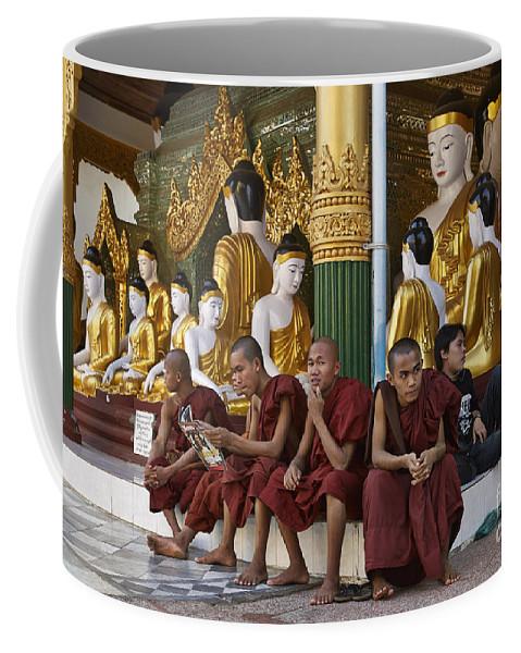 Myanmar Coffee Mug featuring the photograph faithful Buddhist monks siiting around Buddha Statues in SHWEDAGON PAGODA by Juergen Ritterbach