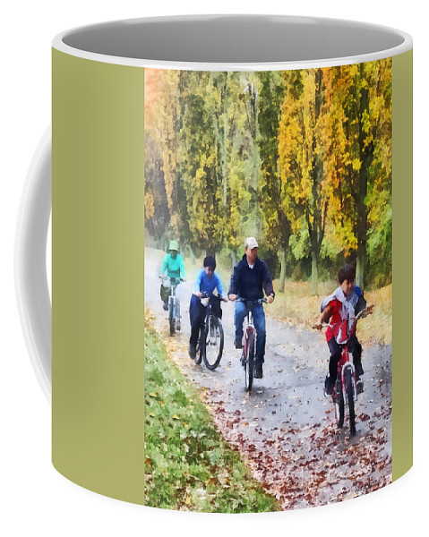 Autumn Coffee Mug featuring the photograph Family Bike Ride by Susan Savad