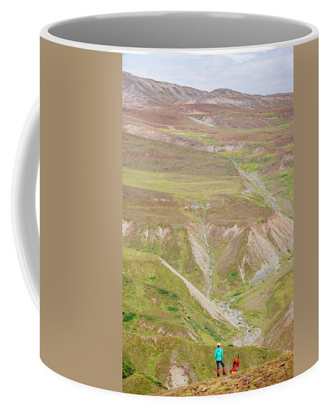 Alaska Coffee Mug featuring the photograph Female Hiker Standing With A Backpack by Andrew Peacock