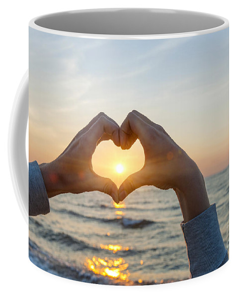 Heart Coffee Mug featuring the photograph Fingers Heart Framing Ocean Sunset by Elena Elisseeva