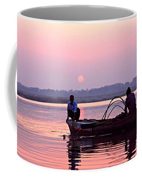 Hindu Pilgrim Coffee Mug featuring the photograph Fisherman On The Ganges River At Varanasi by Amanda Stadther