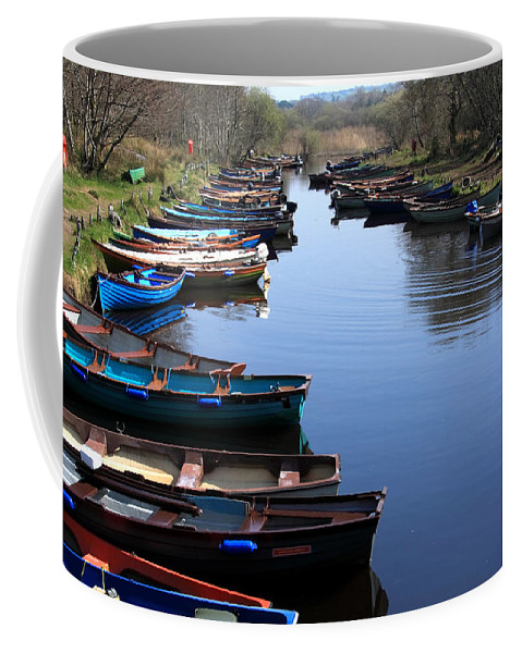 Ireland Coffee Mug featuring the photograph Fishing Boat Row by Aidan Moran