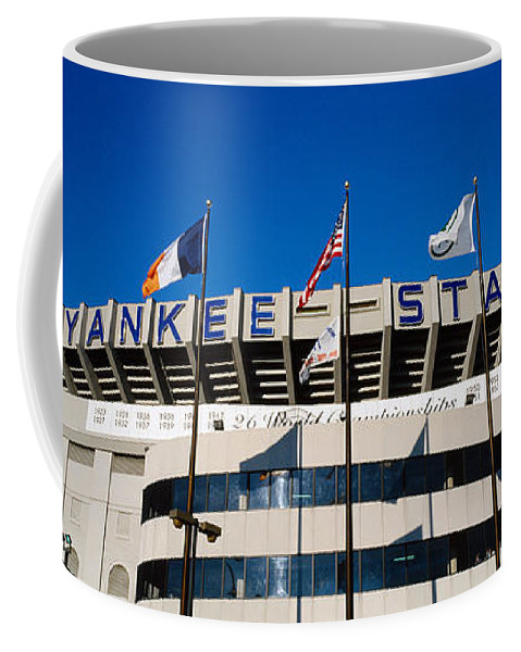 Photography Coffee Mug featuring the photograph Flags In Front Of A Stadium, Yankee by Panoramic Images