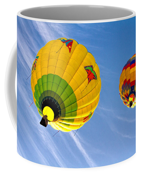 Hot Air Balloon Coffee Mug featuring the photograph Floating Upward Hot Air Balloons by Bob Orsillo