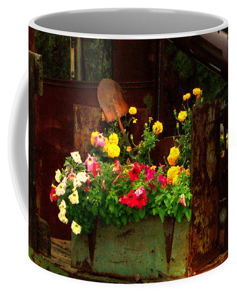 Deckers Coffee Mug featuring the photograph Flowers And Shovel On An Old Drill Truck by Lanita Williams