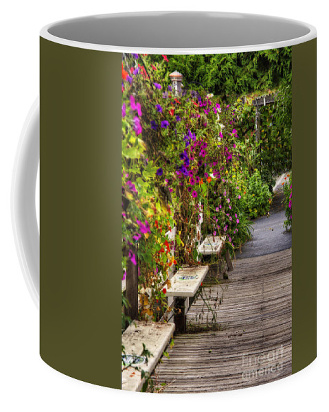 2011 Coffee Mug featuring the photograph Flowers By A Bench by Larry Braun