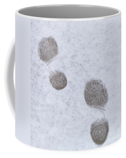 Footprint Coffee Mug featuring the photograph Footprints In The Snow by Diane Macdonald