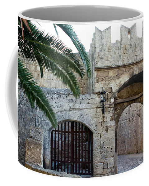 The Island Of Rhodes Coffee Mug featuring the photograph Fronds Over Castle Doorway by Lorraine Devon Wilke