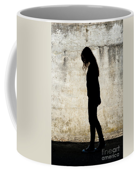 Coupville Coffee Mug featuring the photograph Girl Walking In Front Of Cement Wall by Jim Corwin