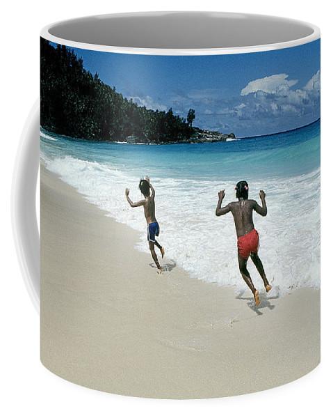 Kids Coffee Mug featuring the photograph Girls On A Beach by Buddy Mays