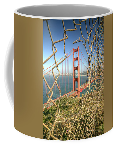Golden Gate Coffee Mug featuring the photograph Golden Gate through the fence by Scott Norris