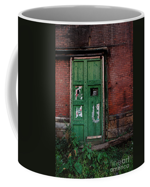 Green Coffee Mug featuring the photograph Green Door On Red Brick Wall by Amy Cicconi