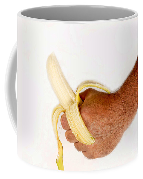 Banana Coffee Mug featuring the photograph Hand Holding A Banana by James BO Insogna