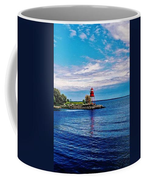Harbor Light Coffee Mug featuring the photograph Harbor Light by Daniel Thompson
