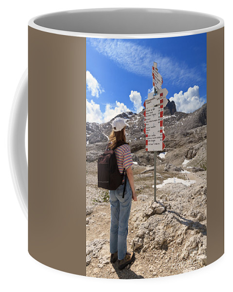 Alpine Coffee Mug featuring the photograph Hiker And Directions by Antonio Scarpi