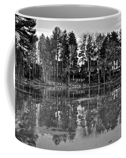 Icy Coffee Mug featuring the photograph Icy Pond Reflects by Frozen in Time Fine Art Photography