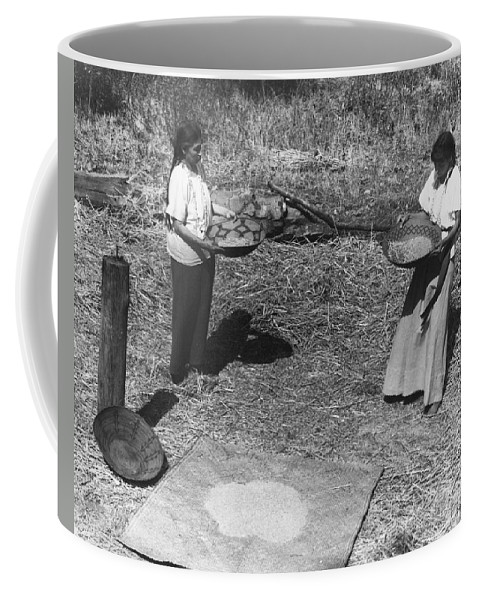 1930 Coffee Mug featuring the photograph Indian Women Winnowing Wheat by Underwood Archives Onia
